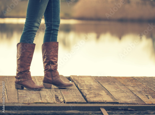 Fototapeta The girl's legs and retro boots obraz