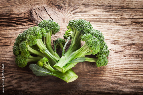 Fresh broccoli on the wooden table Canvas Print