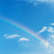 beautiful colorful rainbow on blue sky background