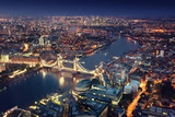 Fototapeta Londyn - London at night with urban architectures and Tower Bridge