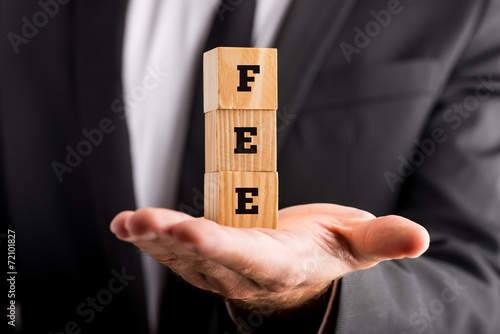 Fotografía  Businessman holding wooden blocks reading Fee