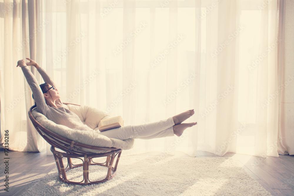 Fototapeta Woman relaxing in chair