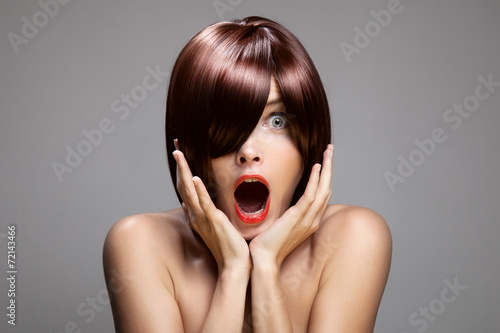 Fotografie, Obraz  Surprised woman with perfect long glossy brown hair. Close-up po