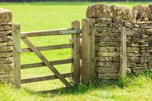 Rustic Gate In Drystone Wall In Bibury England UK.