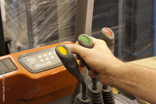 Fotografía Male hand controlling forklift truck lever