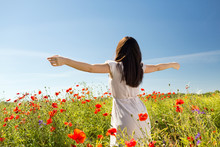 Young Woman On Poppy Field