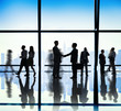 Silhouette Group of Business People Handshake Concept