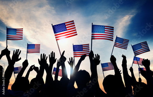Fotografia  Group of People Waving American Flags in Back Lit