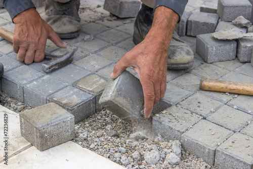 Fotografie, Obraz  laying concrete brick pavers