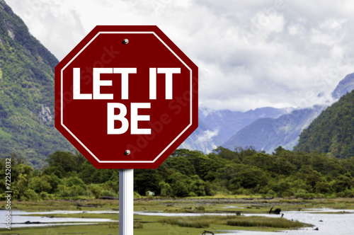 Photo  Let It Be wooden sign with a landscape background