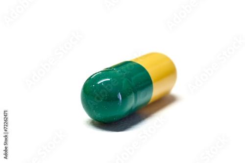 Capsula Verde E Gialla Su Sfondo Bianco Buy This Stock Photo And