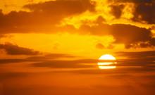 Orange Sky With A Shining Sun