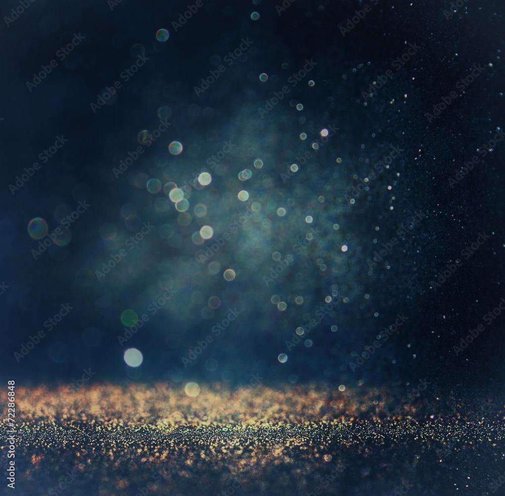 glitter vintage lights background. gold, silver, blue and black.