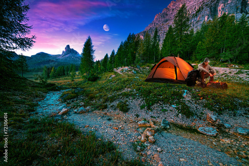 Aluminium Prints Camping At sunrise spotted horse grazing alone on the rocks