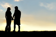 Silhouette Of Happy Couple Hol...