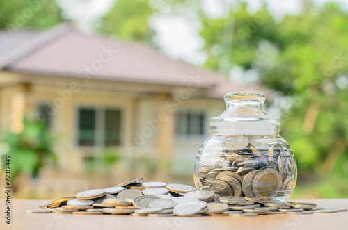 Fotografía  money coins with home, Saving for buy home concept