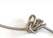An Intricate Knot Formed By A Flexible Metal Hose