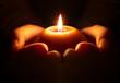 Leinwandbild Motiv prayer - candle in hands