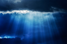 Ray Of Sunlight Pierce A Cloud