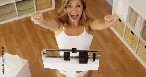 Fotografia Happy woman celebrating weight loss