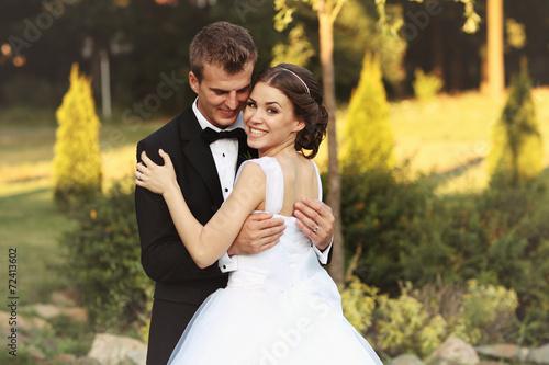 Fotografie, Obraz  Bride and groom in the garden