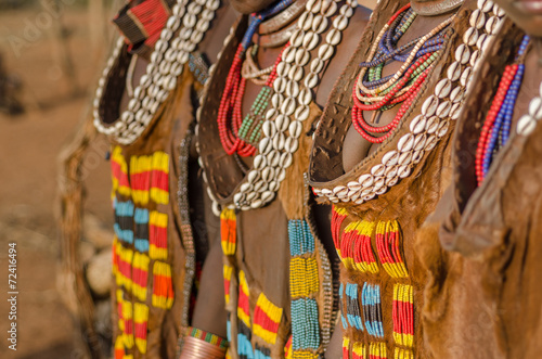 Staande foto Afrika Close up of Hamer tribe women's dresses