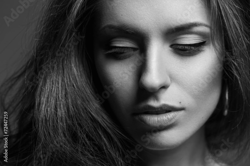 Fotografie, Obraz  Emotive portrait of a fashionable model with curly hair and natu
