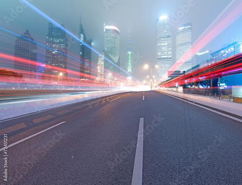 Foto op Plexiglas F1 Asphalt road and modern city