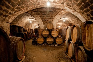 Fototapeta Do winiarni Barrels in a hungarian wine cellar