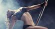 Leinwandbild Motiv Sport. Pole dancer, woman dancing on pylon