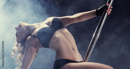 Photo  Sport. Pole dancer, woman dancing on pylon