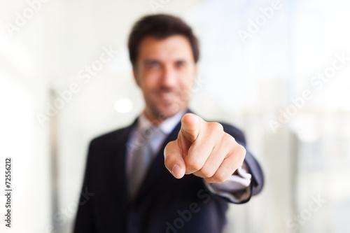 Fototapeta Businessman pointing his finger at you