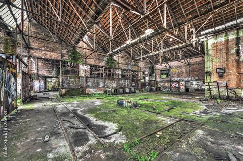 Tuinposter Oude verlaten gebouwen Derelict warehouse in an abandoned coal mine