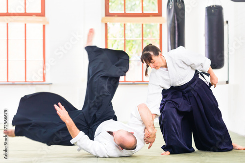 Man and woman fighting at Aikido martial arts school - 72566679