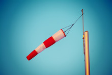 Close Up Of A Wind Sock Under A Blue Sky In Vintage Tone