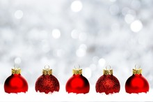 Christmas Border Of Red Baubles In Snow With Silver Background