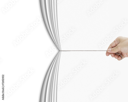 human hand pulling open white blank curtain with empty behind Canvas Print