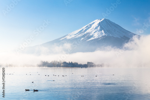 Mountain Fuji and Kawaguchiko lake with morning mist in autumn s