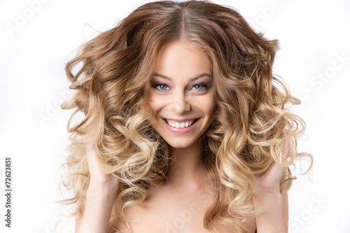 Fotografie, Obraz  Portrait smiling girl with luxuriant hair curling.