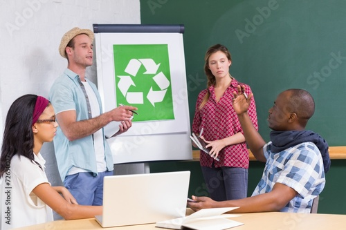 Fotografie, Obraz  Creative meeting with recycling symbol on whiteboard