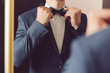 canvas print picture - Groom with Bowtie before Mirror