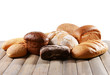 Fresh bread on table on white background
