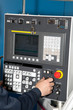 Man hand the controls of a machine CNC