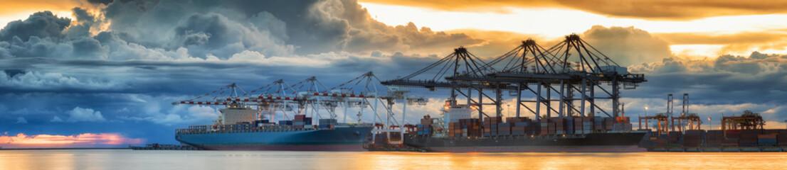 Fototapeta Container Cargo freight ship with working crane loading bridge i