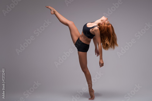 Foto op Aluminium Dance School Woman gymnast stretching