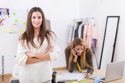 Fotografia, Obraz  Young attractive females fashion designers leaning on office des