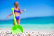 Beach kid's toys on white sand