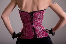 Rear View Of Elegant Woman Wearing Purple Corset