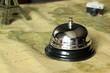 Hotel service bell on vintage background. Travel concept