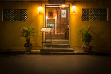 Entry To Old Cafe At Night In Vietnam, Asia.